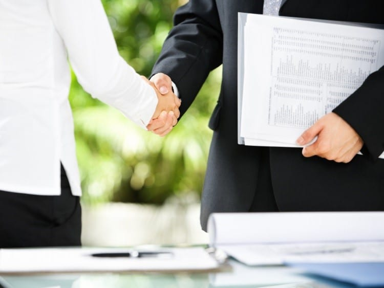 Handshake between businessman and businesswoman